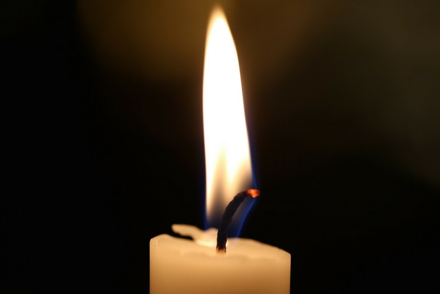 a lite candle with a black background