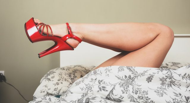 woman in red high heels
