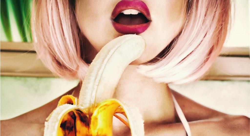 woman seductively eating a banana