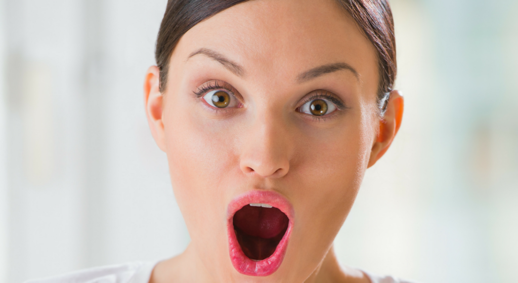 woman shocked opening her mouth