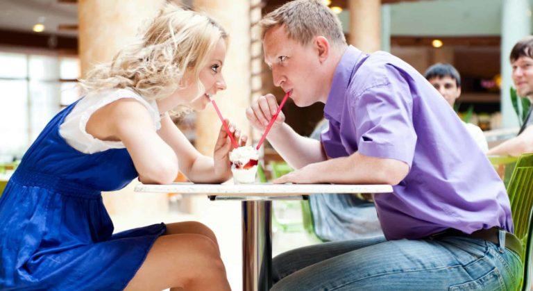 couple drinking milkshake on a date night