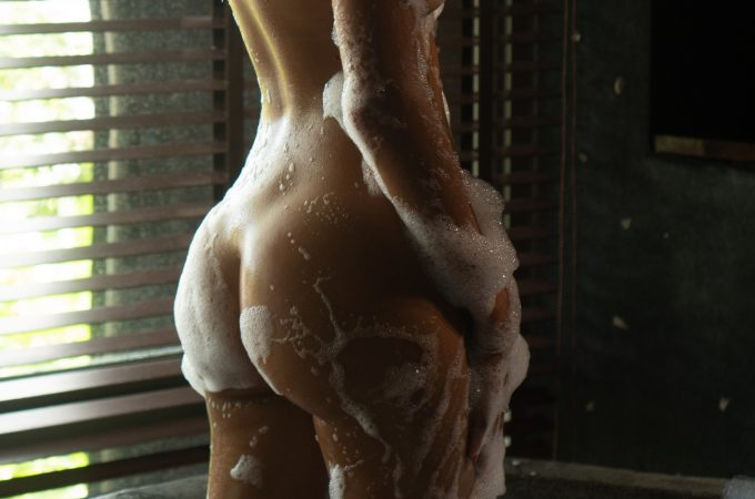 woman in shower covered in bubbles